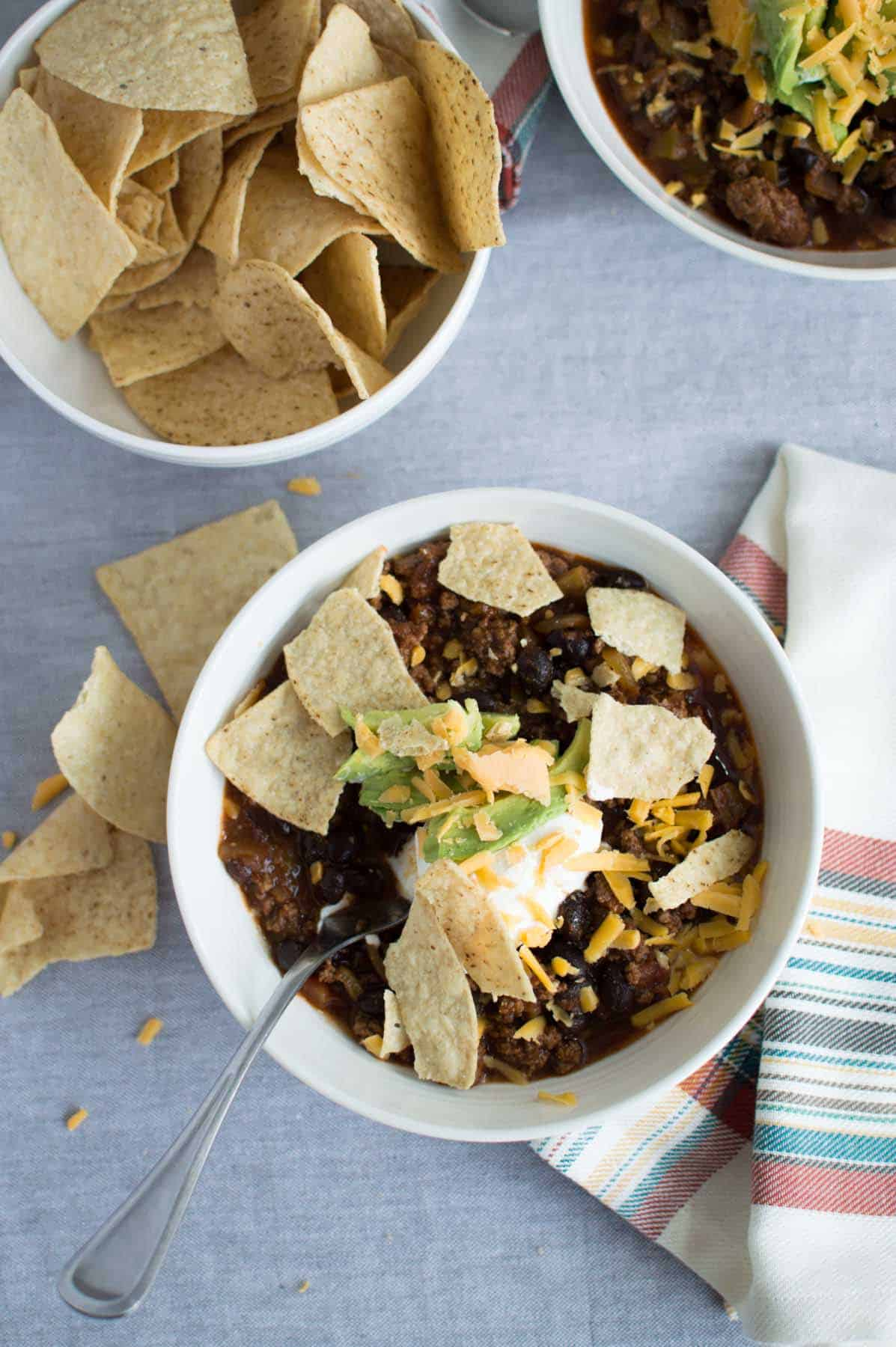 Bowl of Quick and Easy Black Bean Chili with all the fixings
