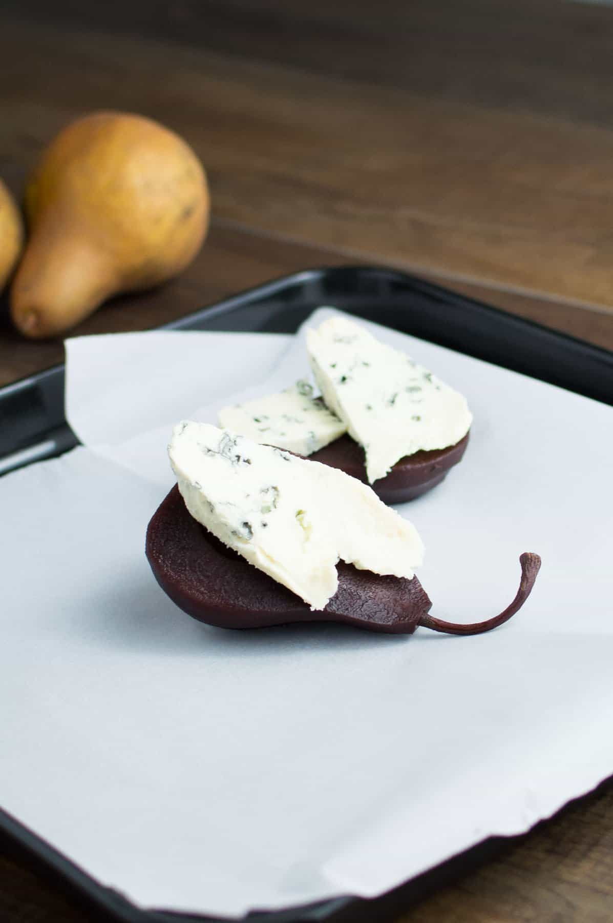 Red Wine Poached Pears with Blue Cheese Ready for Oven
