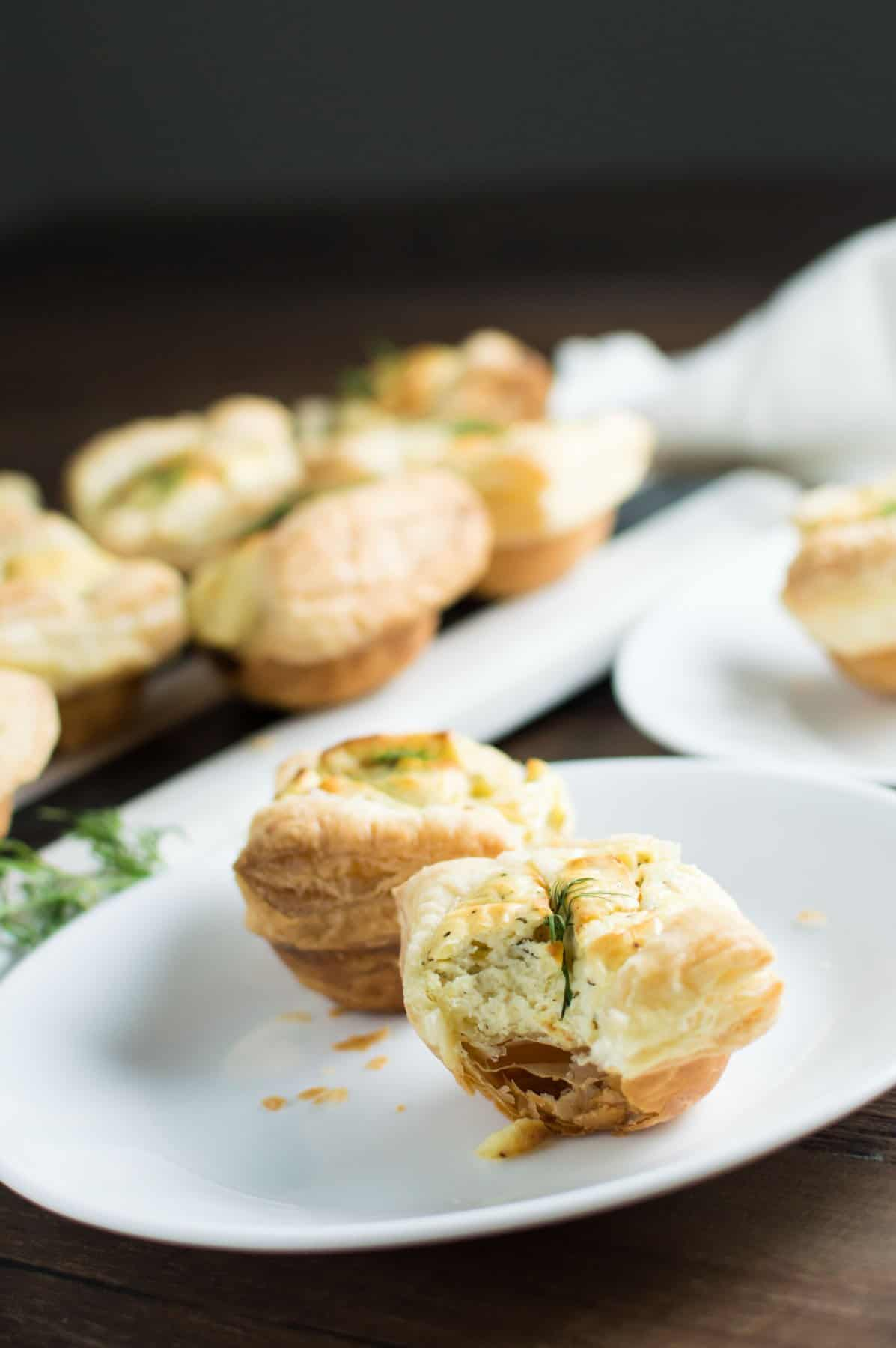 Goat Cheese and Dill Tarts With Bite Taken Out