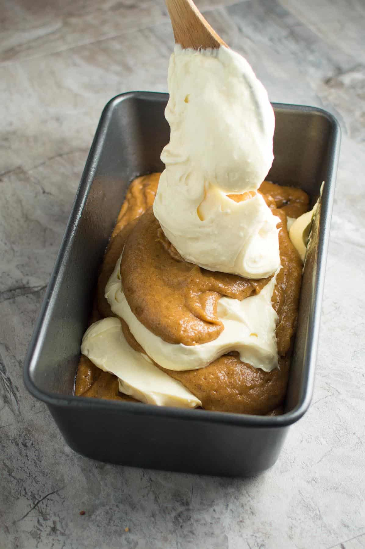 Layering Pumpkin Cream Cheese Swirl Cake Batter in Pan