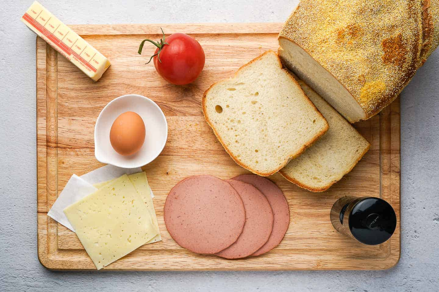 Fried Bologna and Egg Sandwich Ingredients on a Cutting Board