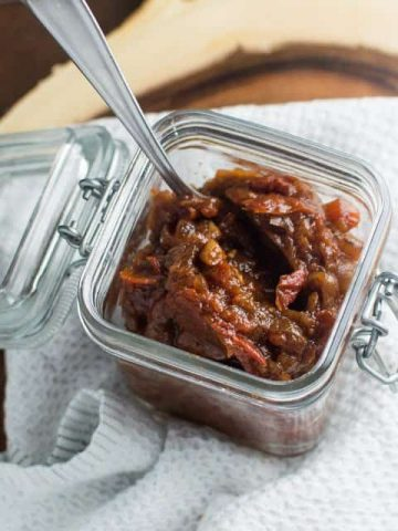 caramelized onion and tomato jam in jar thumbnail