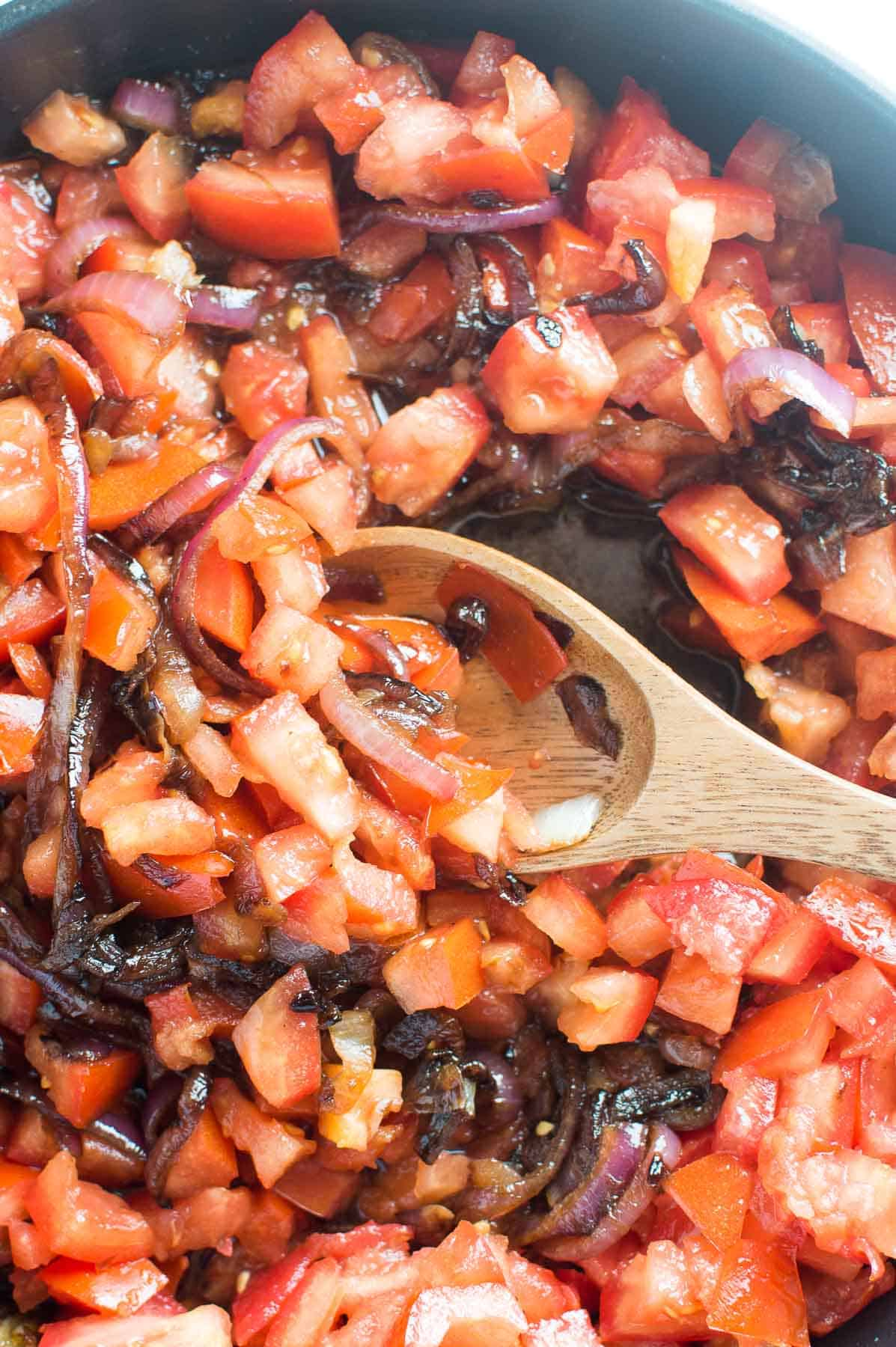caramelized onions and tomato in pan