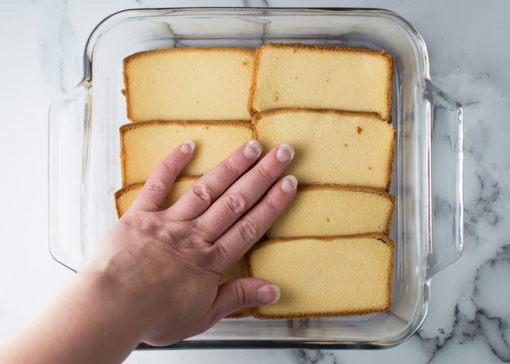 Gently Pressing First Layer of Pound Cake in Pan