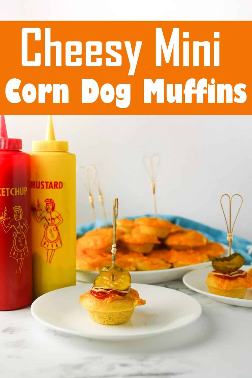 Cheesy Mini Corn Dog Muffins on two plates and platter with ketchup and mustard on the side