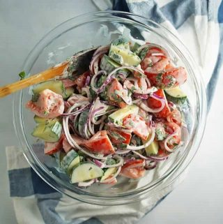 Creamy Tomato Cucumber Salad in glass bowl
