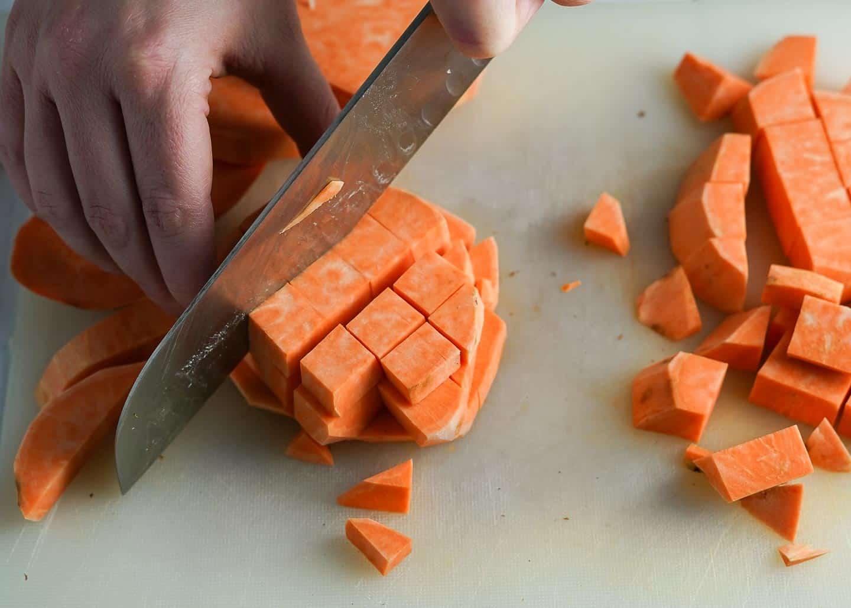 Cubing Sweet Potatoes on Cutting Board