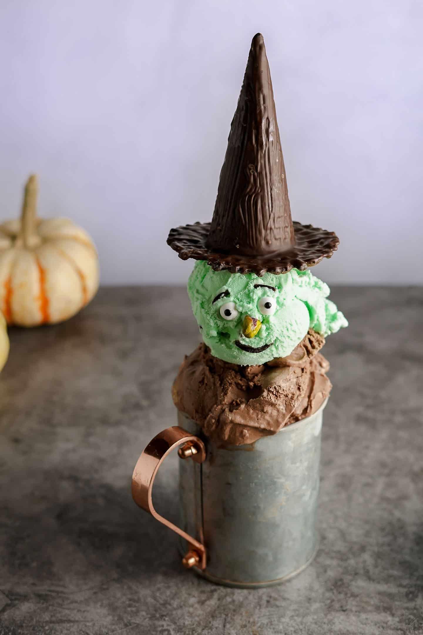 Halloween Ice Cream Sundae with pumpkin in the background