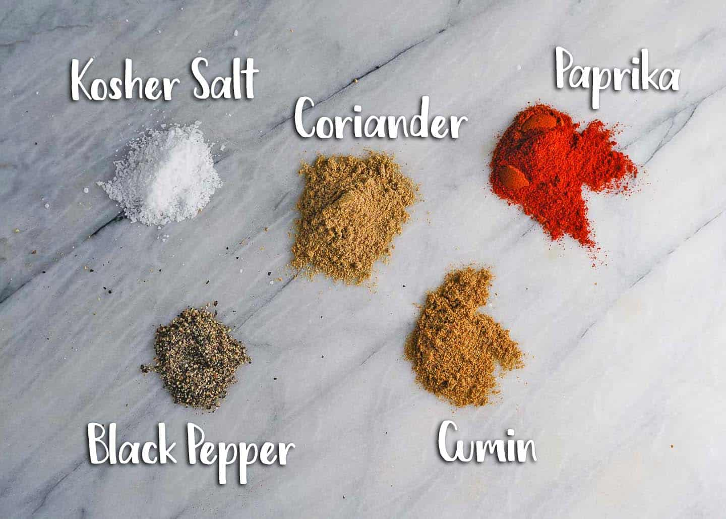 Spices for Turkey Sweet Potato Soup on marble board