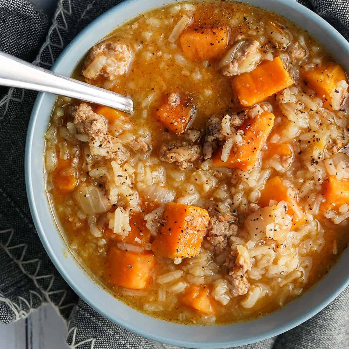 Turkey Sweet Potato Soup in blue bowl with spoon