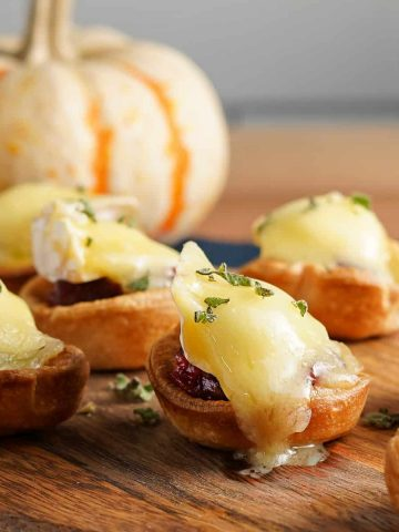 Cranberry Brie Tarts on Tray with pumpkin in the background