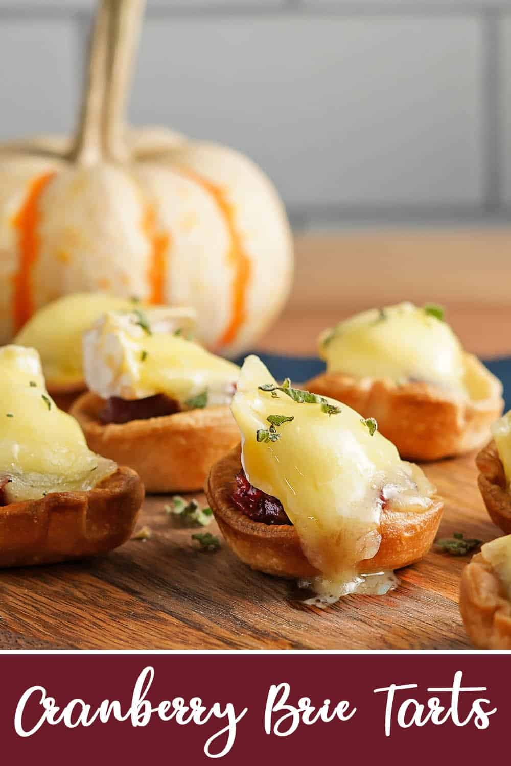 Cranberry Brie Tarts with pumpkin in the background