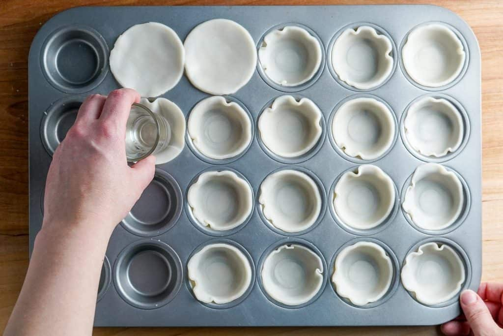Pressing Pie Dough into Mini Muffin Tins