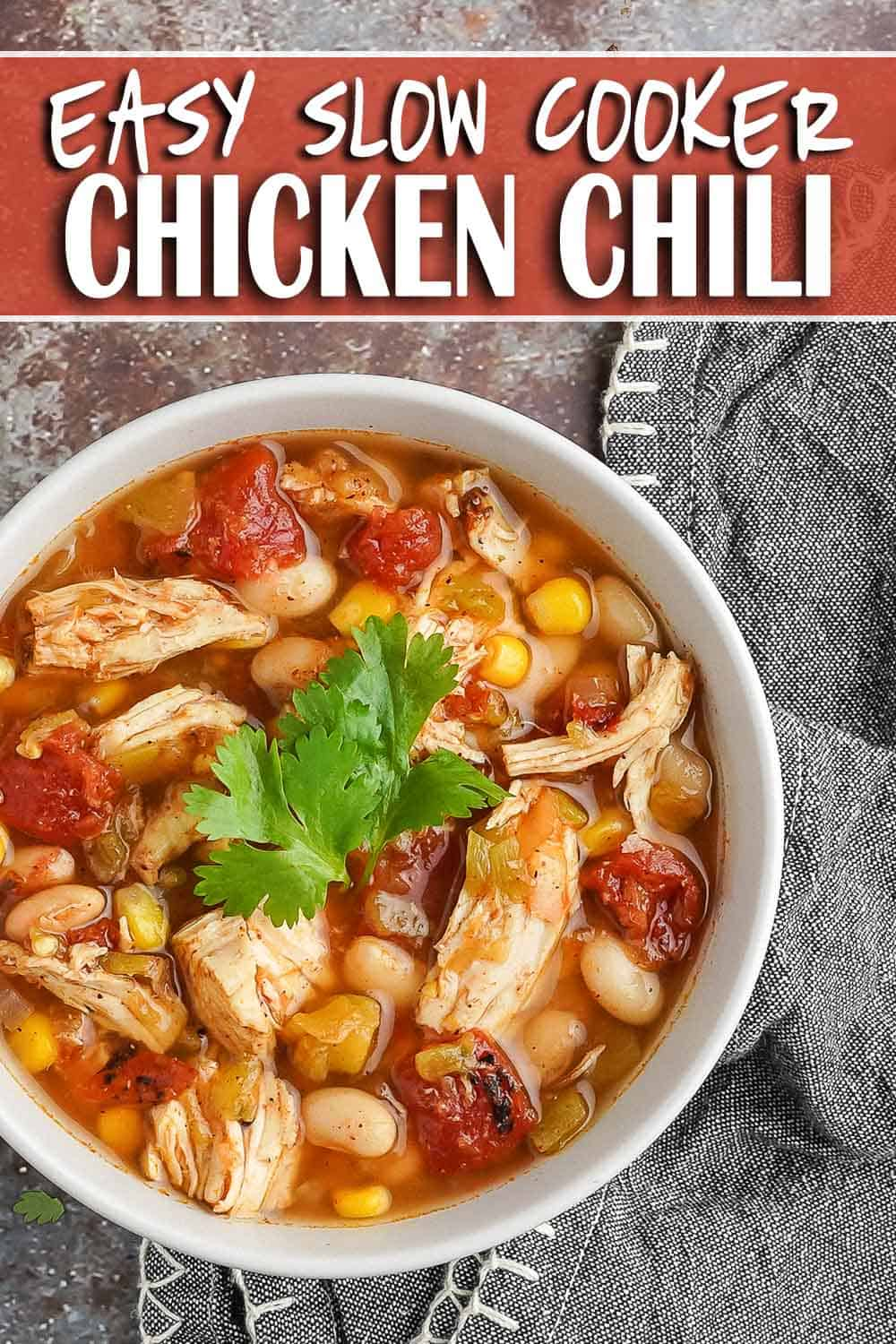 Easy Slow Cooker Chicken Chili in bowl with napkin on the side