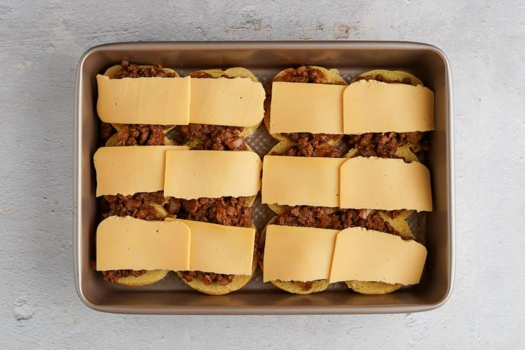 Half Slices of American Cheese Laid Across Sloppy Joe Sliders