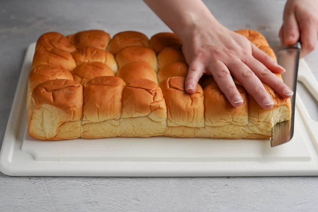 Cutting Party Rolls Horizontally on a Cutting Board