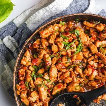 Close up view of teriyaki chicken in skillet