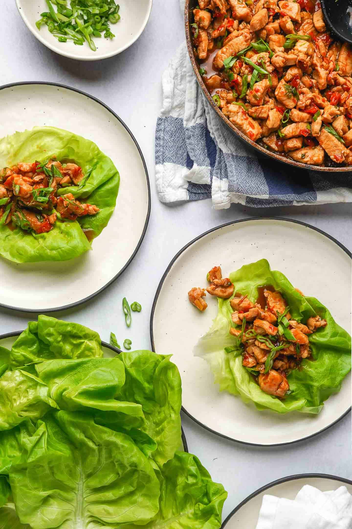 Teriyaki Chicken Lettuce Wraps Ready to Eat on two plates with lettuce on the side
