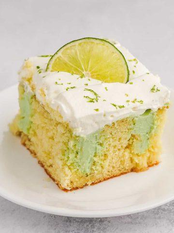 Key Lime Poke Cake on White Plate