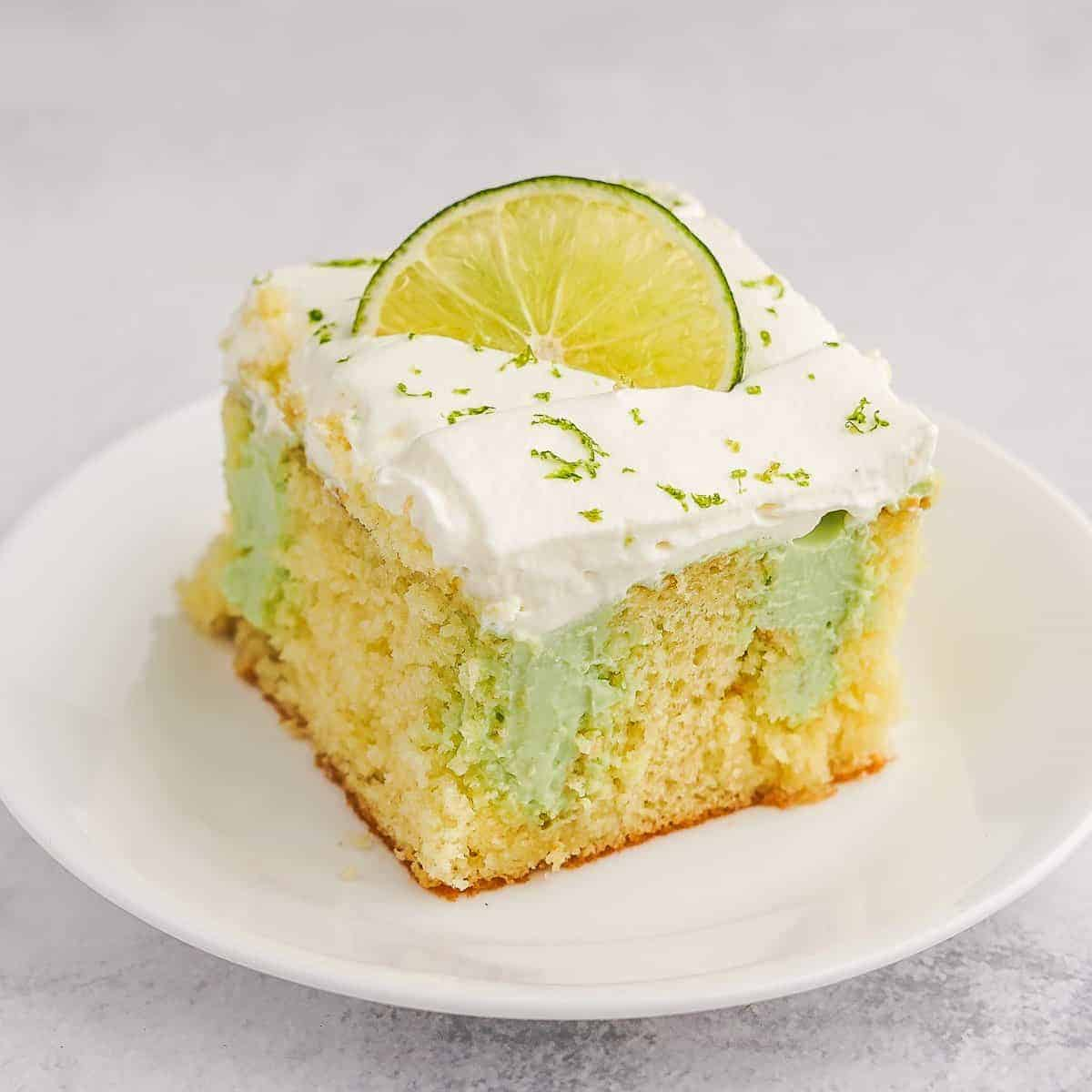 Key Lime Poke Cake on White Plate