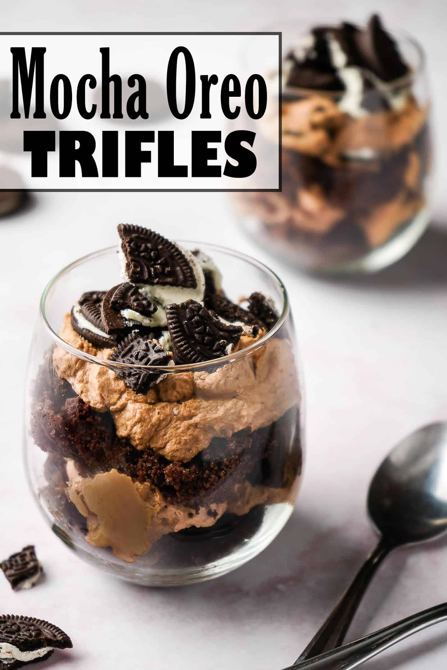 Mocha Oreo Trifles in two glasses with broken Oreos on the side