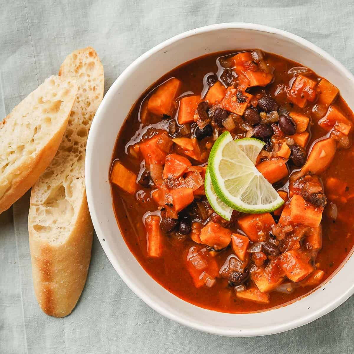 Sweet Potato Black Bean Soup in a bowl with bread on the side