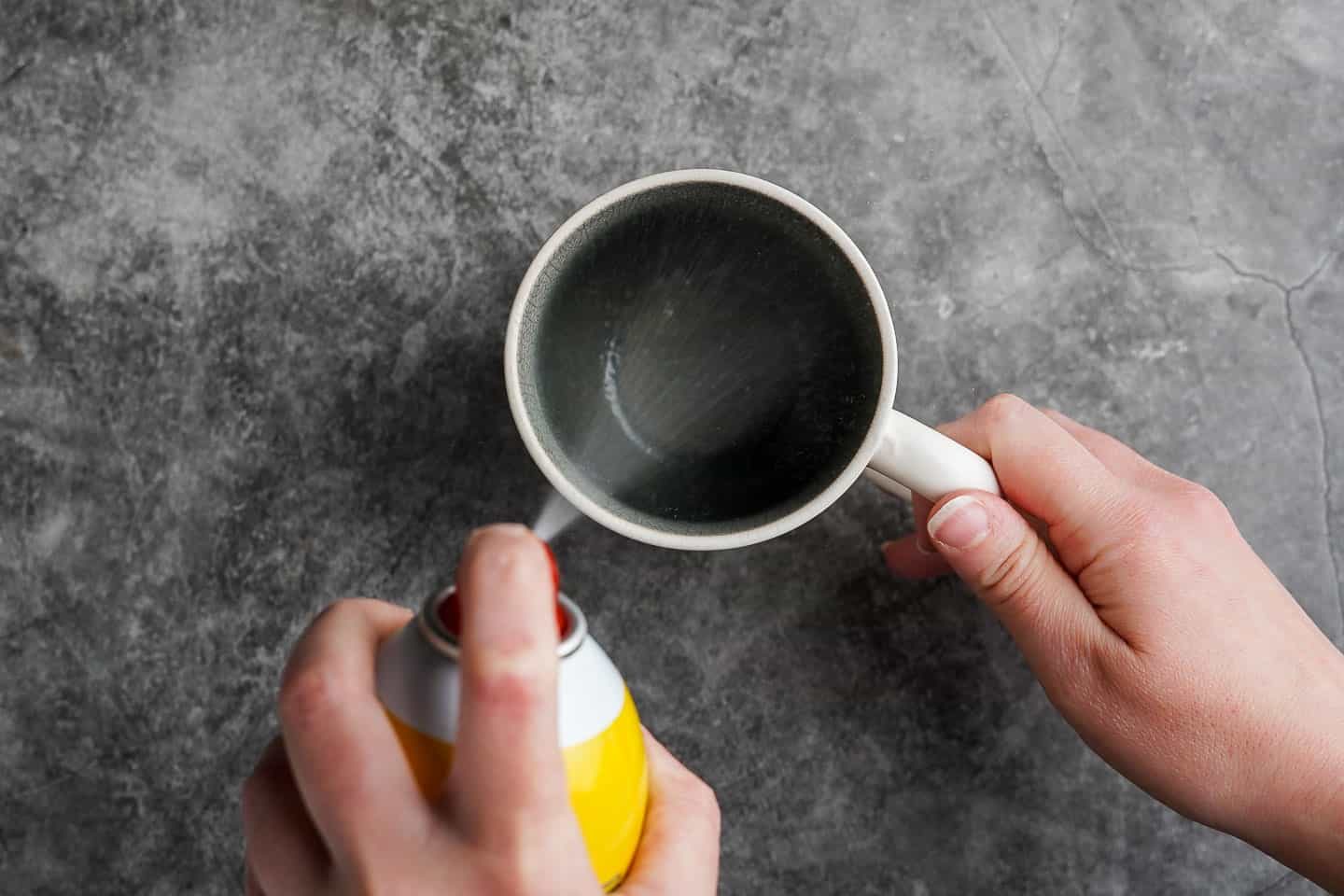 Spraying Mug with Nonstick Spray