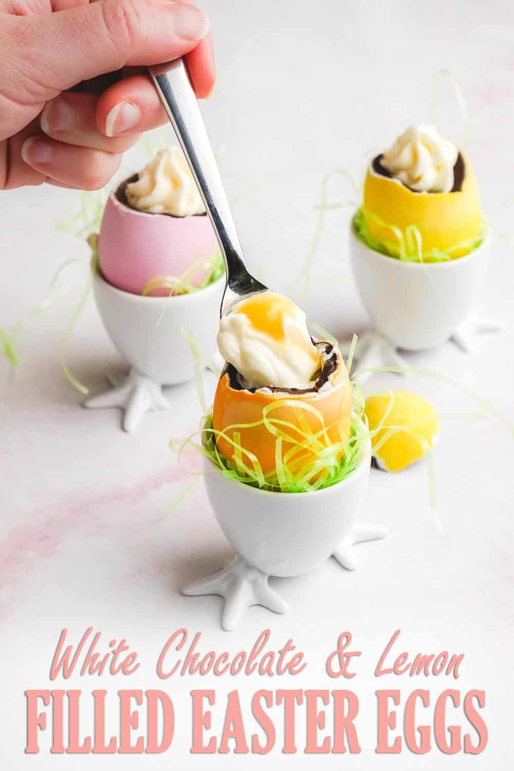 Spoon dipping into White Chocolate and Lemon Filled Easter Eggs