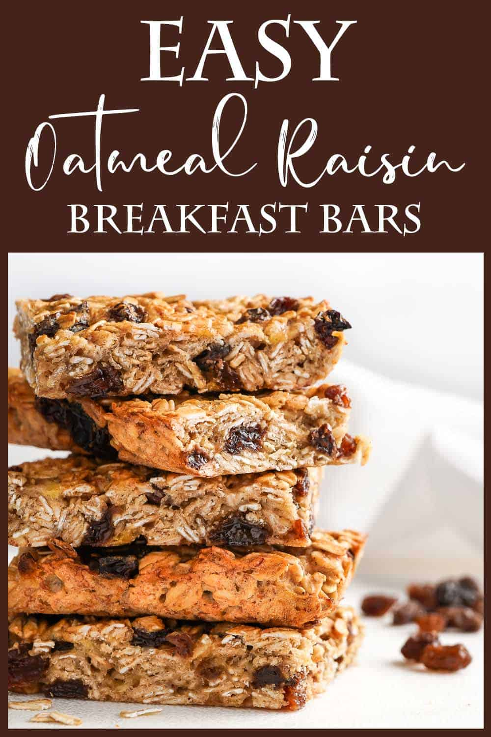 Easy Oatmeal Raisin Breakfast Bars in a stack with raisins on the side