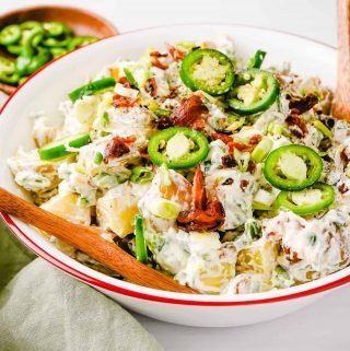 Jalapeno Popper Potato Salad in Bowl with Wooden Spoon