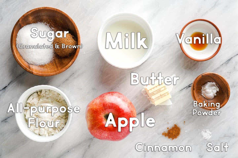 Ingredients used for apple cinnamon mug cake on marble board