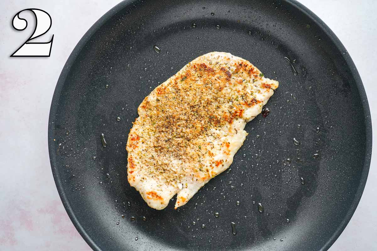seasoned cooked chicken breast in skillet