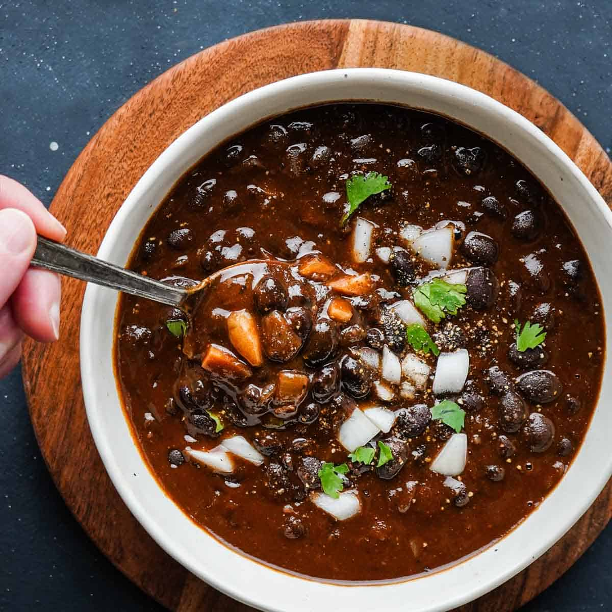 Smoky Black Bean Soup in bowl with spoon inside
