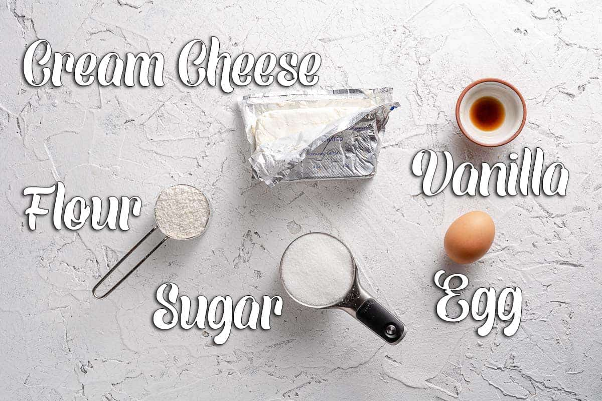 Ingredients for cream cheese layer on white background with text overlay