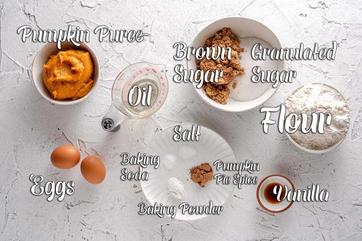 Ingredients for pumpkin batter on white background with text overlay