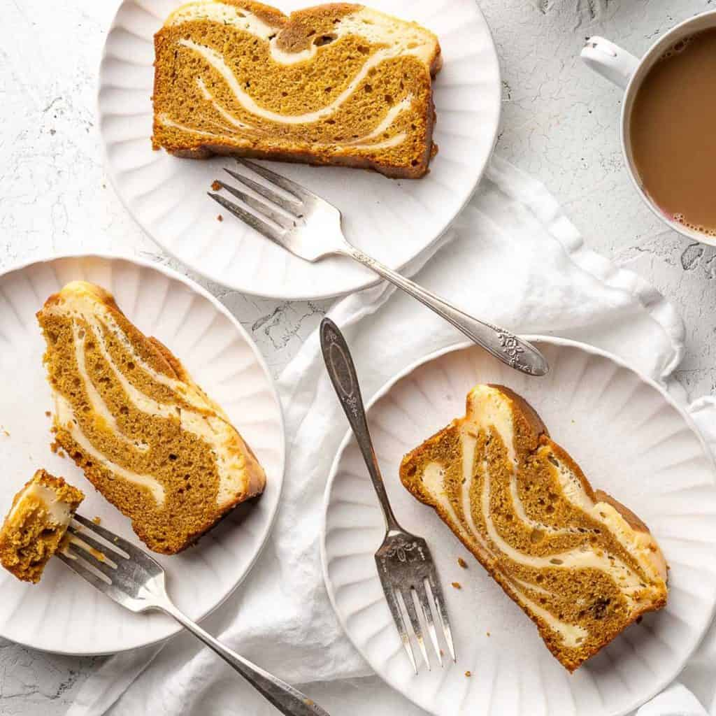 cake on 3 white plates with coffee