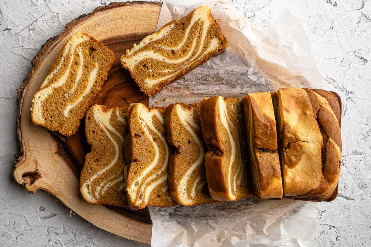 pumpkin cake slices on wooden board with parchment paper