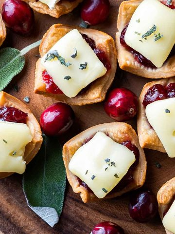 Cranberry Brie Tarts with cranberries and sage on the side