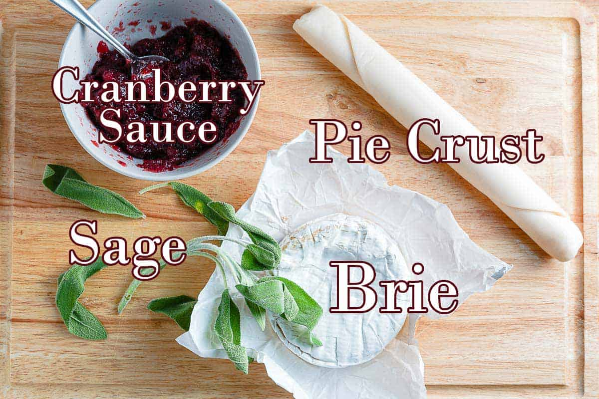 cranberry brie tarts ingredients on wooden board with text overlay