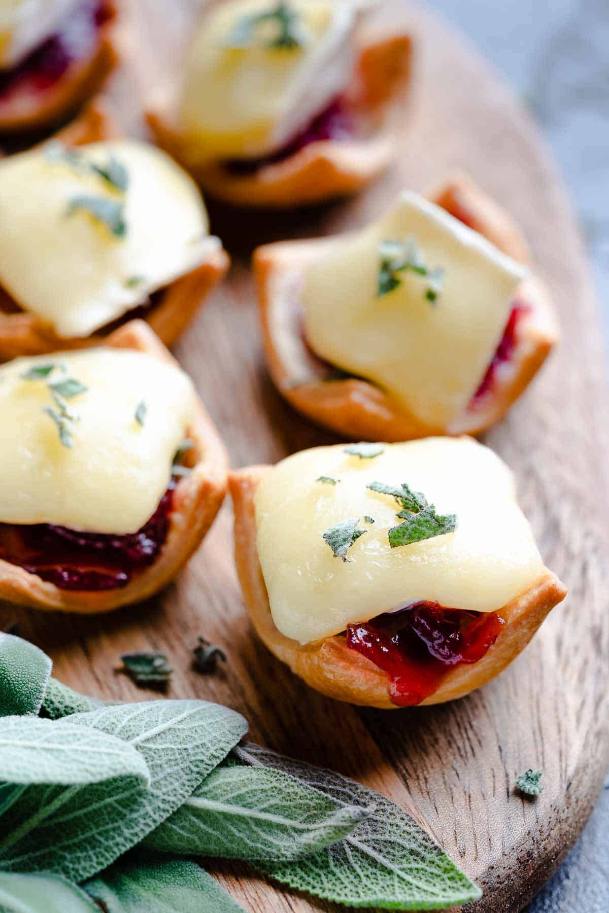 Cranberry Brie Tarts on Board with sage