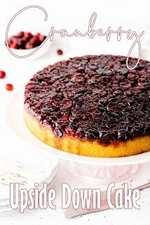 Cranberry upside down cake on a cake stand with text overlay