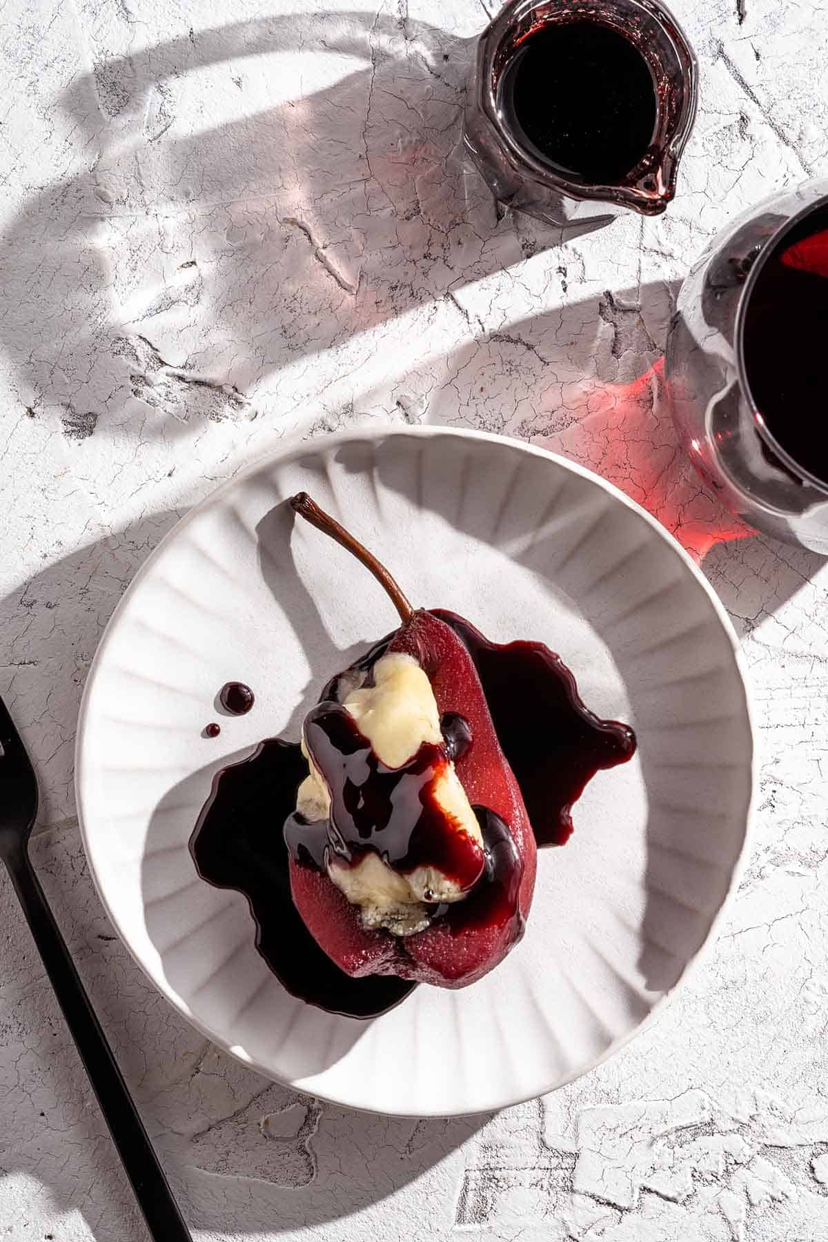 Poached Pear on Plate with wine on the side