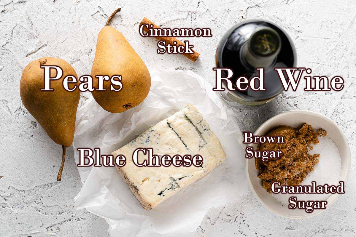 ingredients for poached pears with blue cheese with text overlay