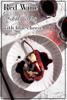 poached pear with blue cheese and red wine syrup on white plate with text overlay