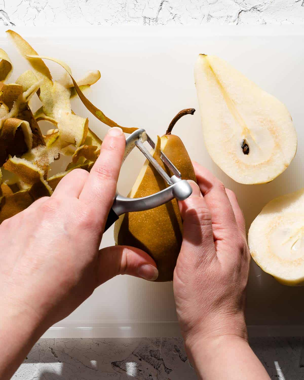 peeling pear with vegetable peeler