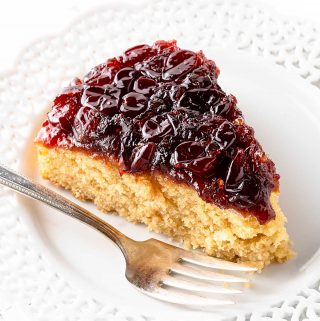 Slice of Cranberry Upside Down Cake on Plate with Fork