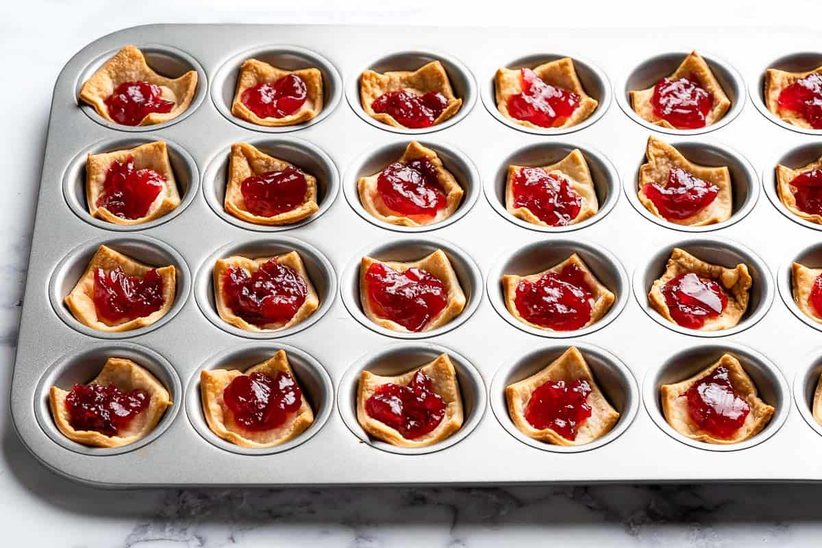 tart shells with cranberry sauce on top