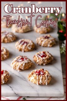 cranberry thumbprint cookies on marble board with text overlay