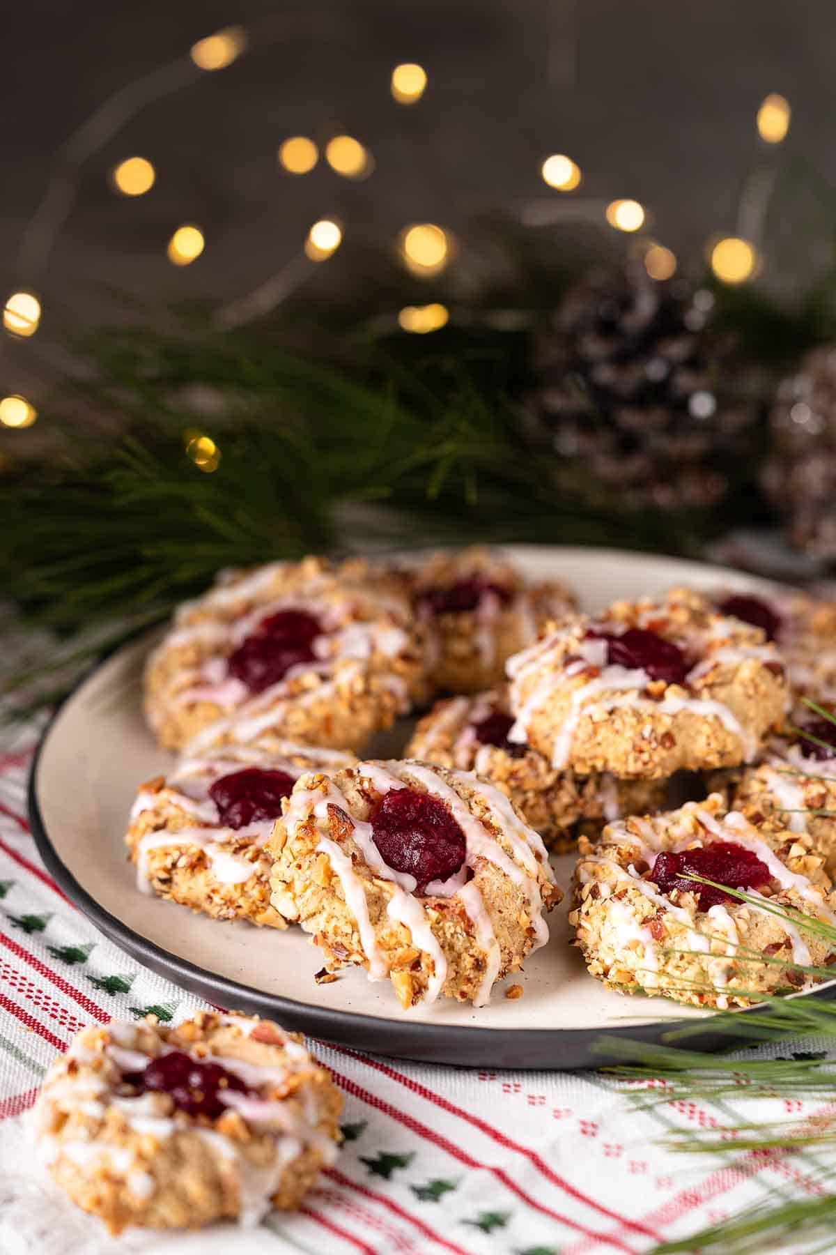Cranberry Thumbprint Cookies on plate with twinkle lights in the background
