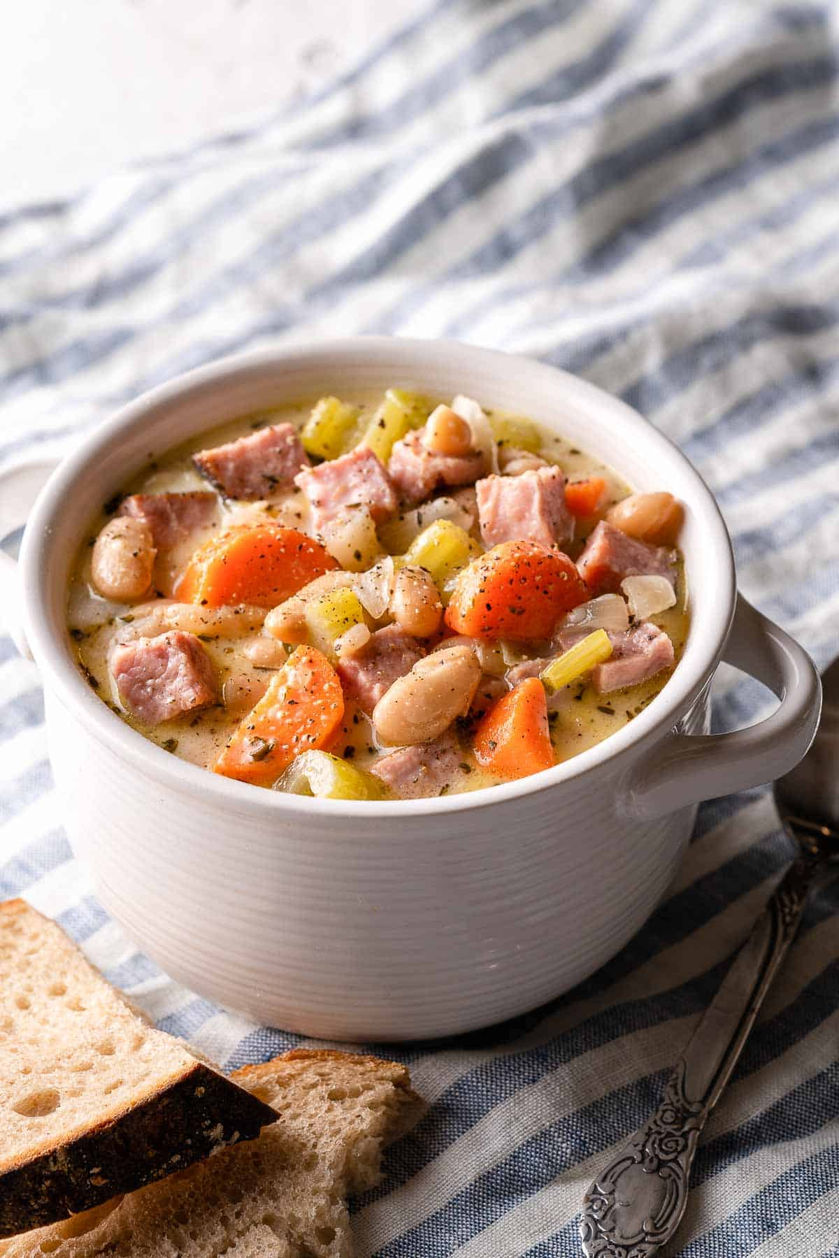 ham and white bean chowder in white bowl